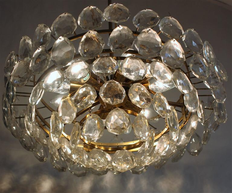 Mid-Century Modern high quality and heavy nine-light crystal and brass chandelier. Bakalowits, Austria,circa 1960s. Socket: 9 xEdison (e14) for standard screw bulbs. Excellent condition.