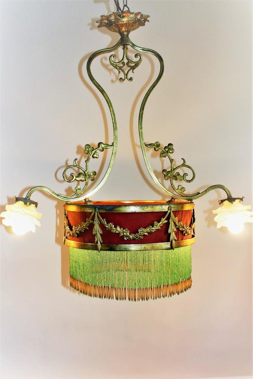 A wonderful antique gilt bronze four-light chandelier with glass roses. France, circa 1880-1890s. Socket: four x B22 (bajonnett) In a good condition with old patination, new screws and wiring.