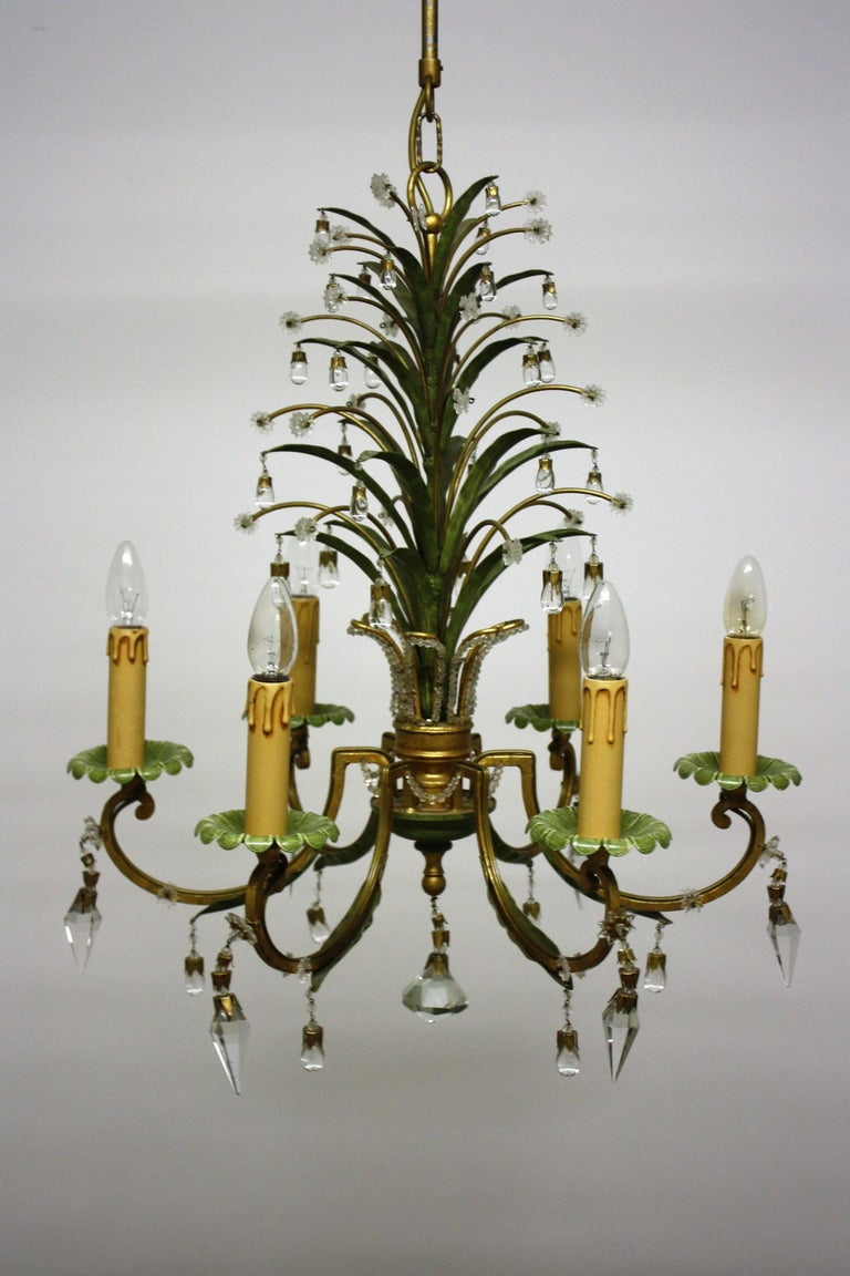 Wonderful pineapple chandelier attributet of Maison Bagues, circa 1950s. This beautiful handcrafted chandeier is made of patinated and gilt metal, decorated with crystals tear drops and prism. Socket: 6 x E14 Edison for standard screw bulbs. The
