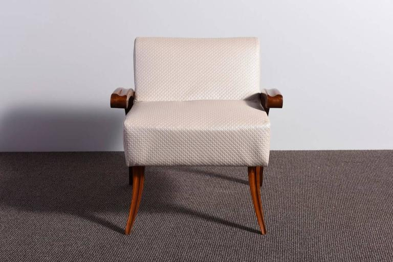 Elegant and rare 1930s Art Deco armchair, the walnut wooden parts were recently restored with a lustrous handmade French polish and the chair was upholstered with an ivory colored faux leather. Beautiful design. It can be used as a vanity chair or a