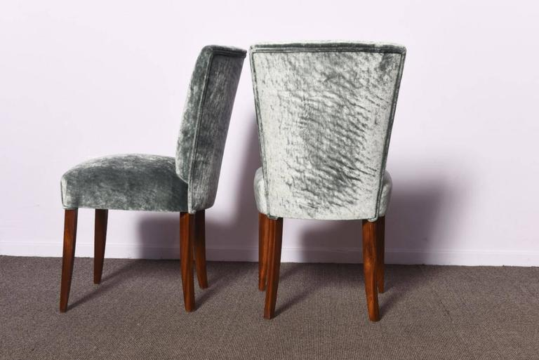 Set of three Art Deco dining chairs. One with arms. Mahogany frame and silvered blue velvet upholstery. The chairs were completely restored, repolished, refurbished and reupholstered with silvered blue velvet. 1930, France.