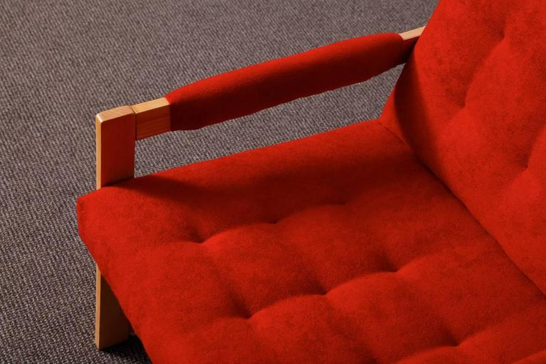 Ashwood pair of armchairs reupholstered with a red colored cotton. The chairs were designed in the spirit of modernism. This simple and modest design makes them very elegant. They suit very well in a living room or in a bed room. They match