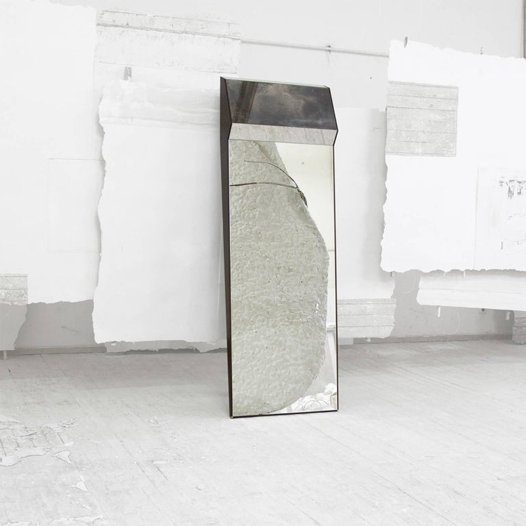 Composed of multiple handmade mirrors, the Mirror K2 is a full length leaning wood board framed mirror discreetly outlined in polished brass. Posed against the wall in a bedroom or salon, this mirror creates a massive decorative effect.
