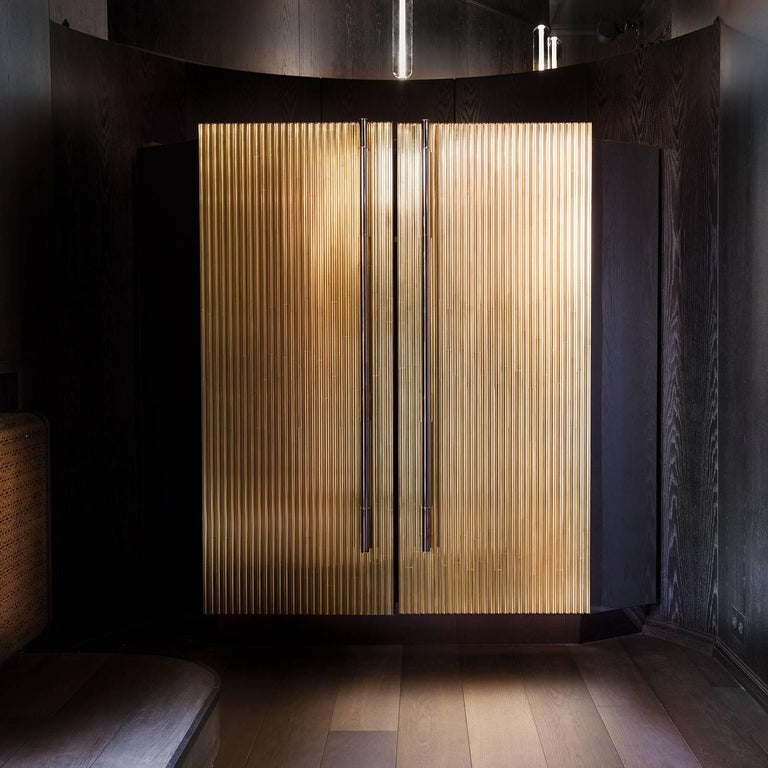 Trabo is a bespoke wooden cabinet with elaborately detailed brass doors created by Sors Privatiselectionem to meet your highest expectations of practicality and style.
