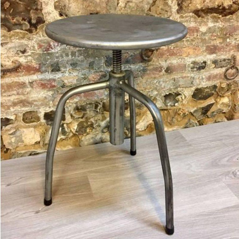 Charmingvintage old original Industrial stools in steel, entirely cover by a nice colorless matte varnish. We add a protection under its legs for protecting your floor. You can adapt easily its height just by turning it.  Measures: Height from
