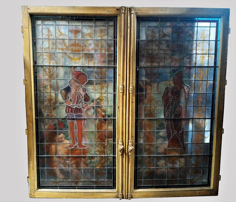 Gorgeous Parisian Renaissance Revival stained glass double window with fantastic colors, ornements and Renaissance characters. Paris, 19th century, circa 1880.  Original window Framed in their elegant Parisian style handles. In a very good