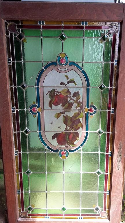Large size beautiful framed two stained glass lead window French Provincial, authentic, with its lock and key, framed, massive oak wood, gorgeous colors with fruits and floral motifs. Made in the old style traditional stained glass french way.