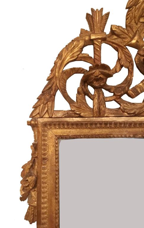 Gesso Late 18th Century French Neoclassical Giltwood Mirror Looking Glass with Crown For Sale