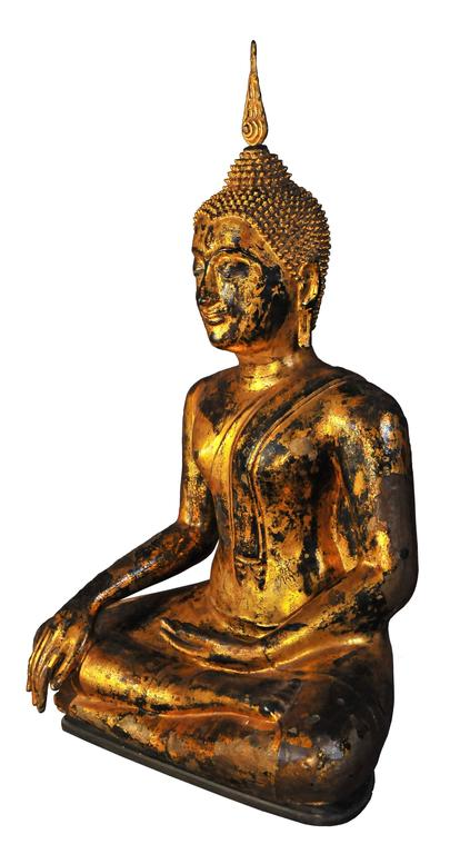 """The founding of the kingdom of Ayuthya by the Prince of U Thong in 1350 also marks the birth of a unified Thailand.  The Master is seated in """"virasana"""", his right leg folded over the other, in the attitude of """"Taking the Earth to"""