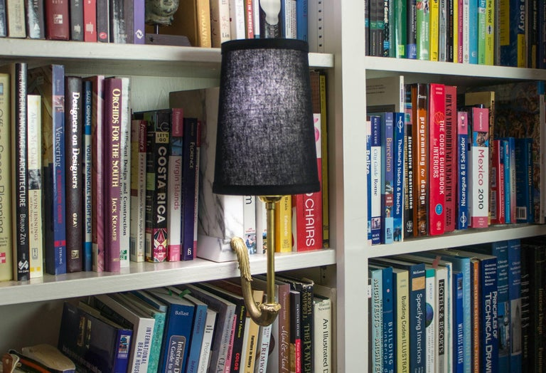 The small bookshelf sconce is design to fit within contemporary or transitional interior and provide functional illumination of the space.