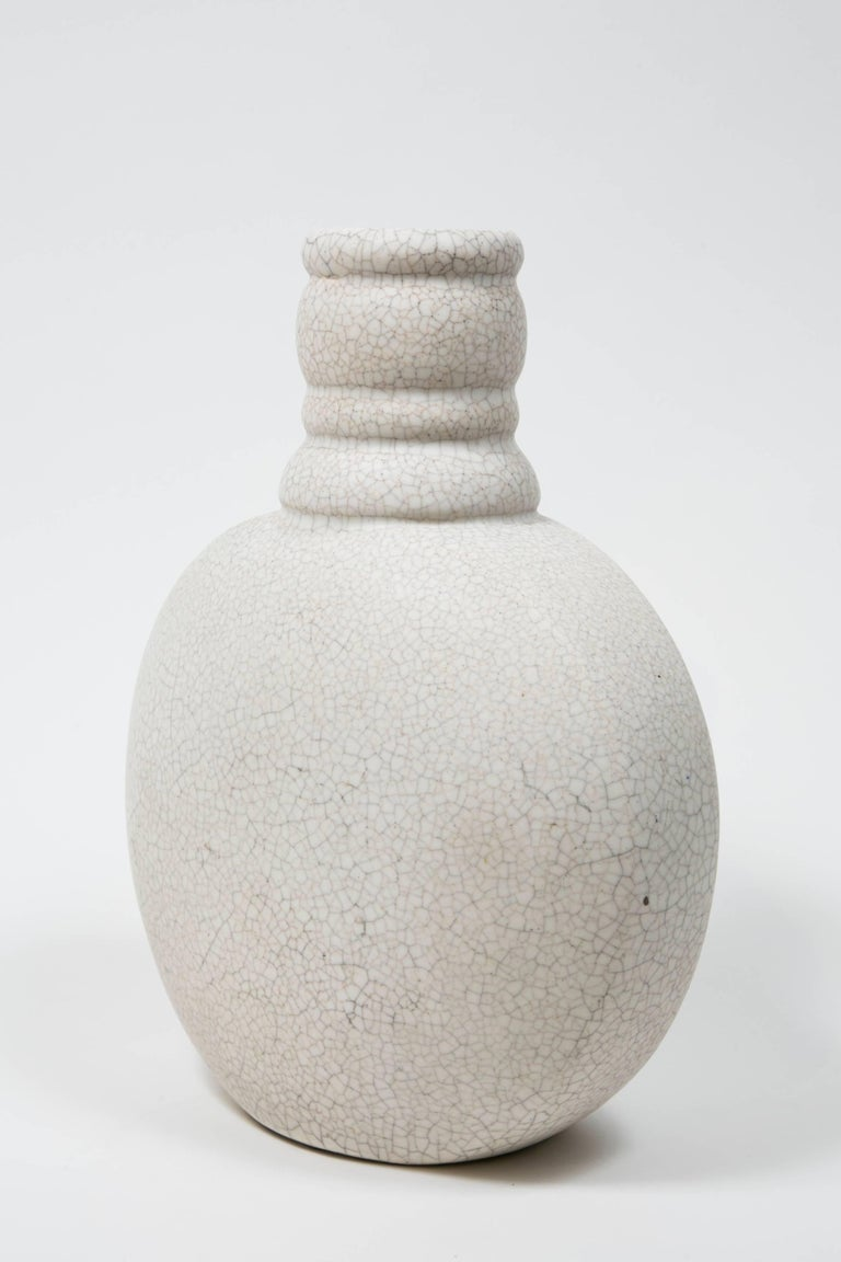 French white craquelure vase by Charlotte Chauchet (1878-1964) for  Atelier Primavera au Printemps  Signed Primavera, France, numbered.