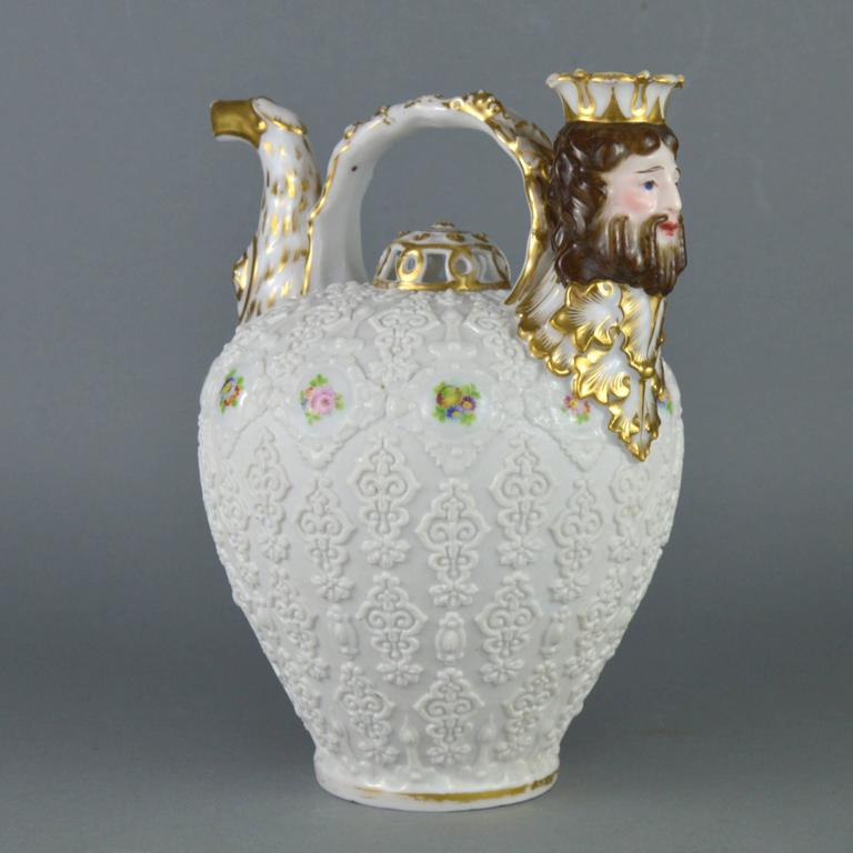Rare collectible porcelain pitcher by important Paris manufacturer Jacob Petit (1840s). The white biscuit oviform body modelled with glazed roundels painted with flower-sprays amongst scrolling arabesques. The spout modelled as an eagle head.