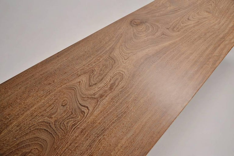 Available for your order.  We created this table for a client in Phuket, Thailand. He choose this particular slab of antique Chickenwing from our collection. This wood had an amazing 'grain' or 'pattern', the chines call this wood Chickenwing wood