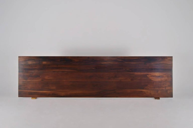 We created this table for a client in Bangkok who was looking for a 'rather large' table. He was impressed by the rather masculine MakhaTae wooden beams we had just bought from an old house on the outskirts of Bangkok. He was rather pleased with the