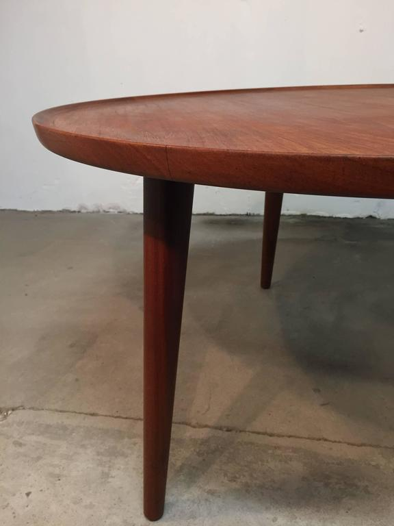 This beautiful circular coffee table in teak, has some amazing details, with angled legs and raised edge. There is no stamp under the table but I am almost sure that it is designed by Anton Kildeberg.