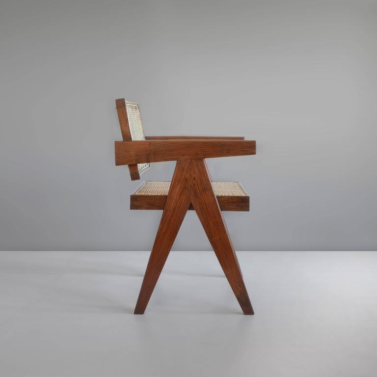 The chair is done in teak. With a free backseat it has a fantastic shape and is an iconic piece of design. Cane has been redone in 2016. All other parts are original. Softly waxed, not lacquered, so wood keeps its natural look. From bottom we keep