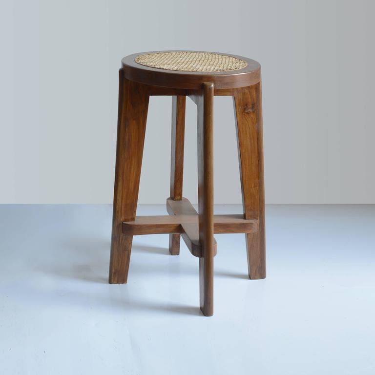 High round stool in solid teak and braided cane work. Circular seat with teak and canework frame, circa 1965. Restored. all wooden parts authentic. Cane has been redone in 2016. Done for Chandigarh. Ask for other photos.  PJ-SI-21-B .