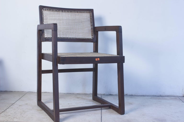 Armchair in solid teak with seat and backrest in braided canework, circa 1960. Fantastic patina. Kept in quit original condition with minimal restoration. Cane has been done in 2016. All other parts are from 1960. We have more of that chair. Very