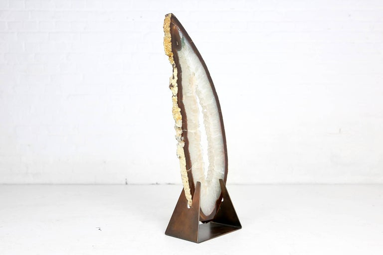A beautiful and rare piece in this color and sice, on a brass base attributed to Willy Daro. We also have an even larger agate on base available (see picture).
