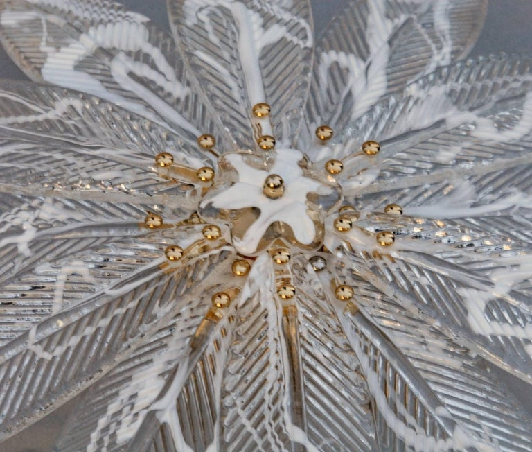 This shallow ceiling mount Murano chandelier was first designed for a luxury vessel ship low ceiling and now is used to pair with Mid-Century Modern Barovier palmette chandeliers, that are usually very tall. This beautiful 12 palm leaves flush mount