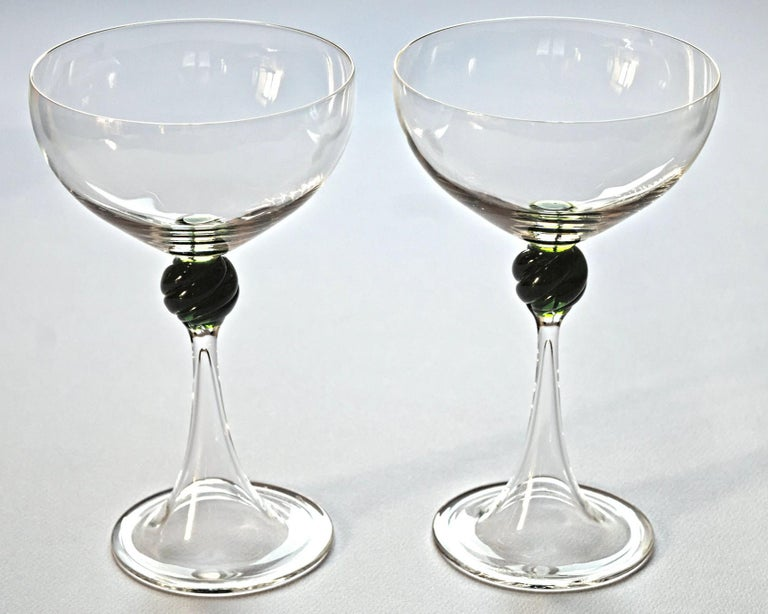 Small set of two Martini glass for a tete dinner.  Shape is taken from the Caravaggio painting of young Bacchus. This is the champagne glass that was used as champagne glass up to the 1970s when than it was replaced with the flute.  Clear vetro