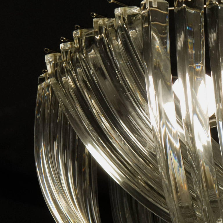 Two iconic midcentury chandeliers from Murano, designed by Carlo Nason. Designed in the 1960s. The use of the triedri elements had been limited to straight fencing around the bulbs, often with different lengths, with a cascade effect. Carlo had the
