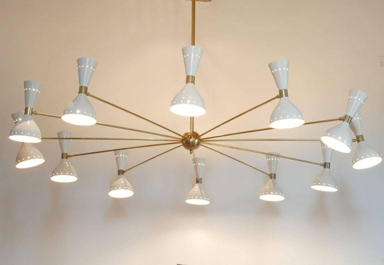 Monumental 80in - 2 meter diameter chandelier. Mid-Century twelve arms spider chandelier with ivory head and natural patinated brass. A statement piece for a large living room, public spaces or loft.   Made by a lab specialized in Mid-Century