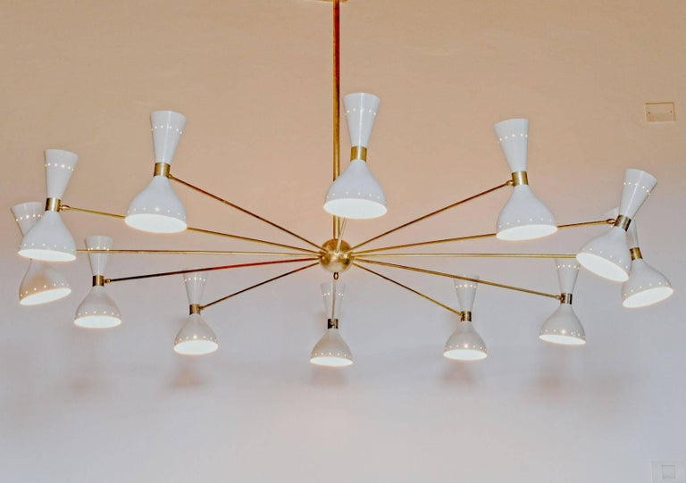 Italian Twelve Arms Natural Patina Brass Chandelier, Ivory Pivoting Heads, Twin Bulbs For Sale