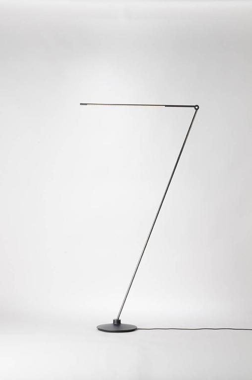 At 58 inch height the floor lamp can be rotated and pivoted to provide reading, accent or ambient light in various different settings. It's thin profile is contemporary, while brass details and tubing combined with a cast iron base create a