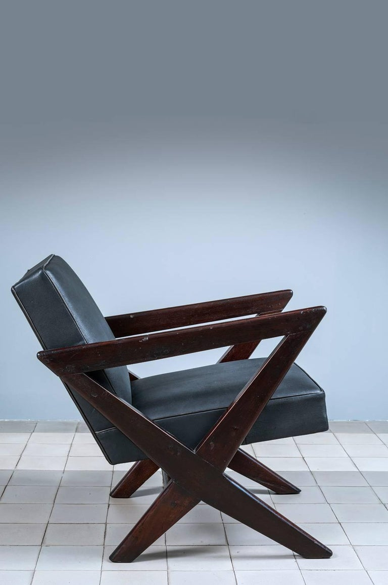 Pierre Jeanneret PJ-SI-45-B «Cross easy armchair», circa1955-1956 Solid teak wood, leather. Provenance: Chandigarh, India.