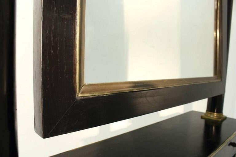 19th Century ebonised French cheval mirror with brass mounts.