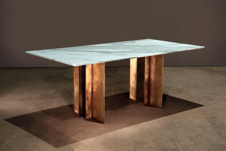 Dining table in Calacatta Bourghini and patinated brass. A collaboration between novocastrian and architecture and interior design studio Lind and Almond. Handcrafted in North East, England.  Measures: 200cm (length) x 100cm (depth) x 75cm
