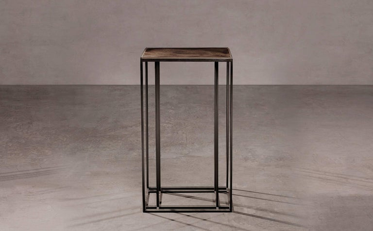 An occasional table by Novocastrian in blackened steel and patinated brass. Handcrafted in North East, England.  Measures: 70cm (height) x 40cm (width) x 40cm (depth). Custom sizes available.  Made to order in 12 weeks. Price excludes VAT.
