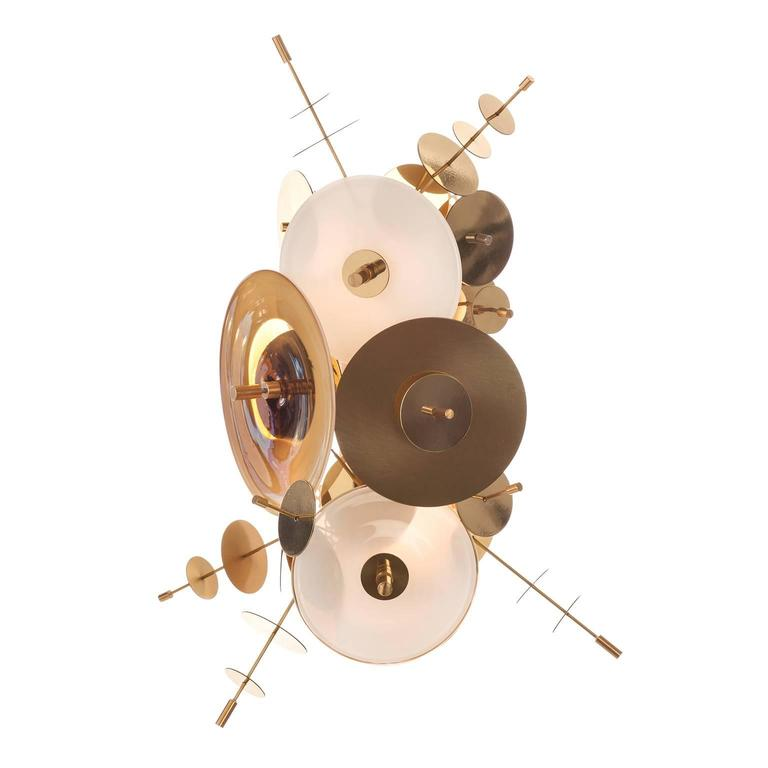 The Confetti Collection Sconce features hand blown glass discs in a variety of color palates combined with hand finished metallic disc accents.    AVRAM RUSU STUDIO is a Brooklyn based design studio known for impeccably crafted and distinctly