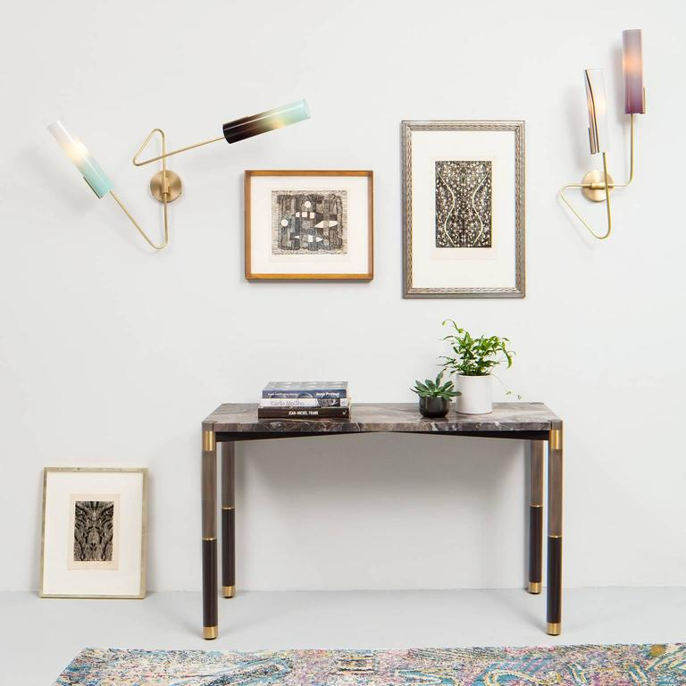 The Continuum collection comprises five sconce models and multiple large scale chandeliers.  Sconces are available handed for symmetrical installation.  AVRAM RUSU STUDIO is a Brooklyn based design studio known for impeccably crafted and distinctly