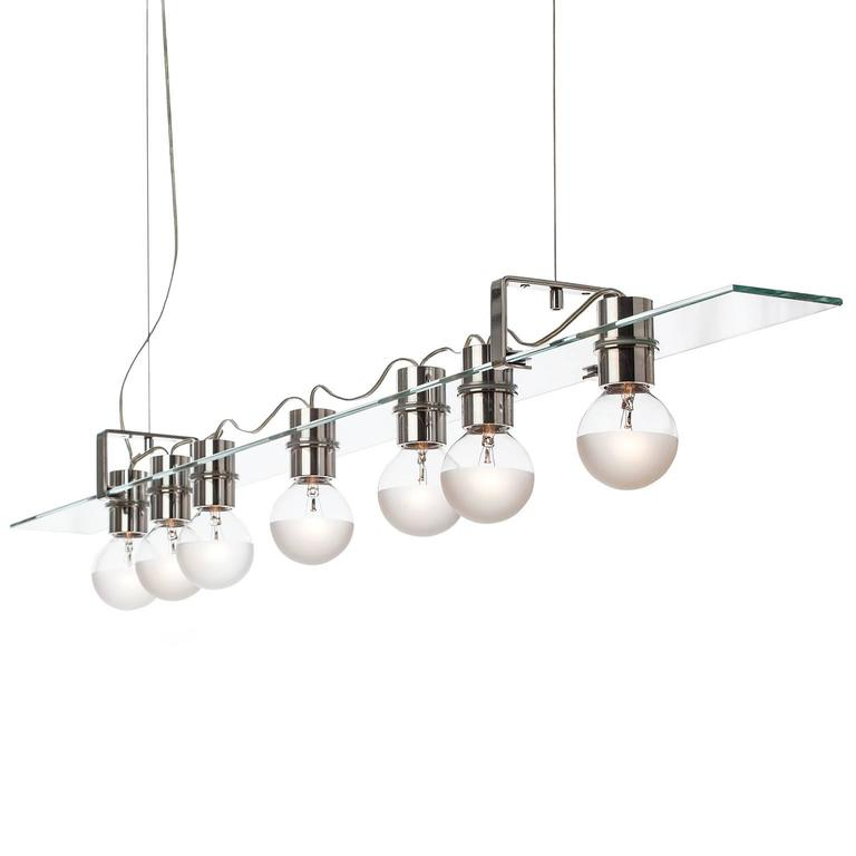 The float pendant features a glass panel held by two sets of interlocking aluminium brackets suspended from stainless steel cables.   AVRAM RUSU STUDIO is a Brooklyn based design studio known for impeccably crafted and distinctly sculptural work.