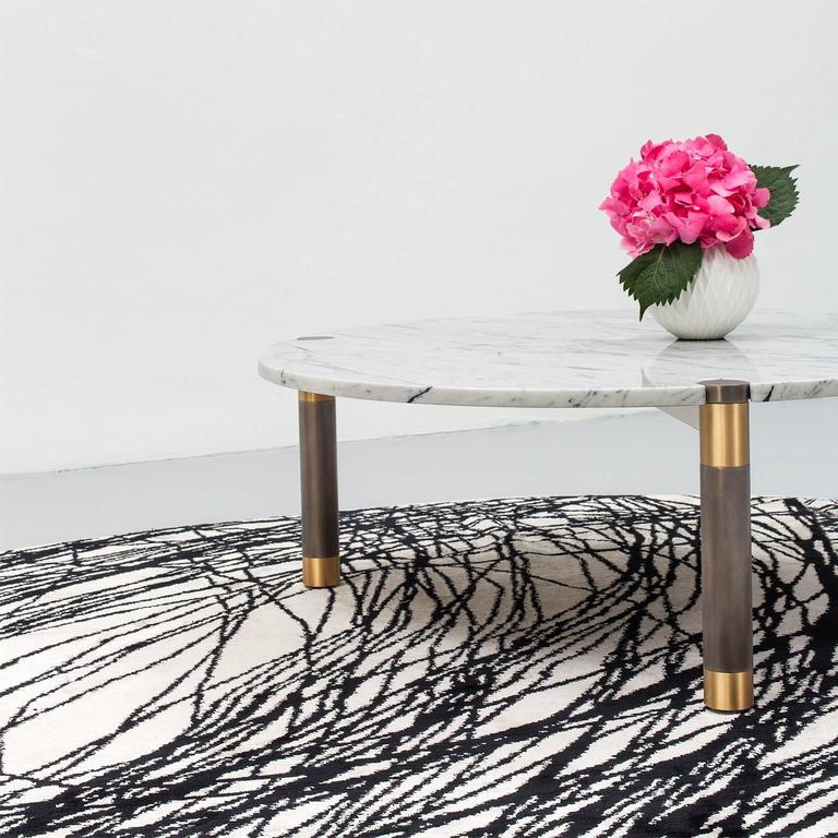 The Nova table collection pairs multiple metal finishes with wood and stone tops of various shapes and sizes. Select from available options or specify your own top and mix of finishes.  Tables are available individually or as a nesting pair, sizes