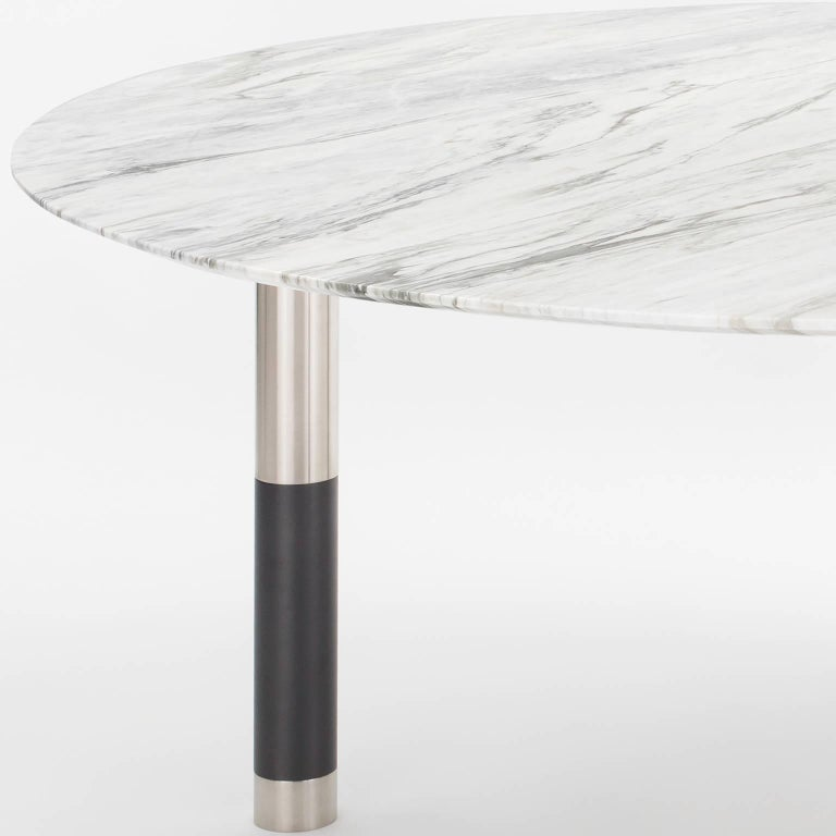 The Nova collection pairs multiple metal finishes with wood and stone tops of various shapes and sizes. Select from available options or specify your own top and mix of finishes.  Avram Rusu Studiois a Brooklyn based design studio known for