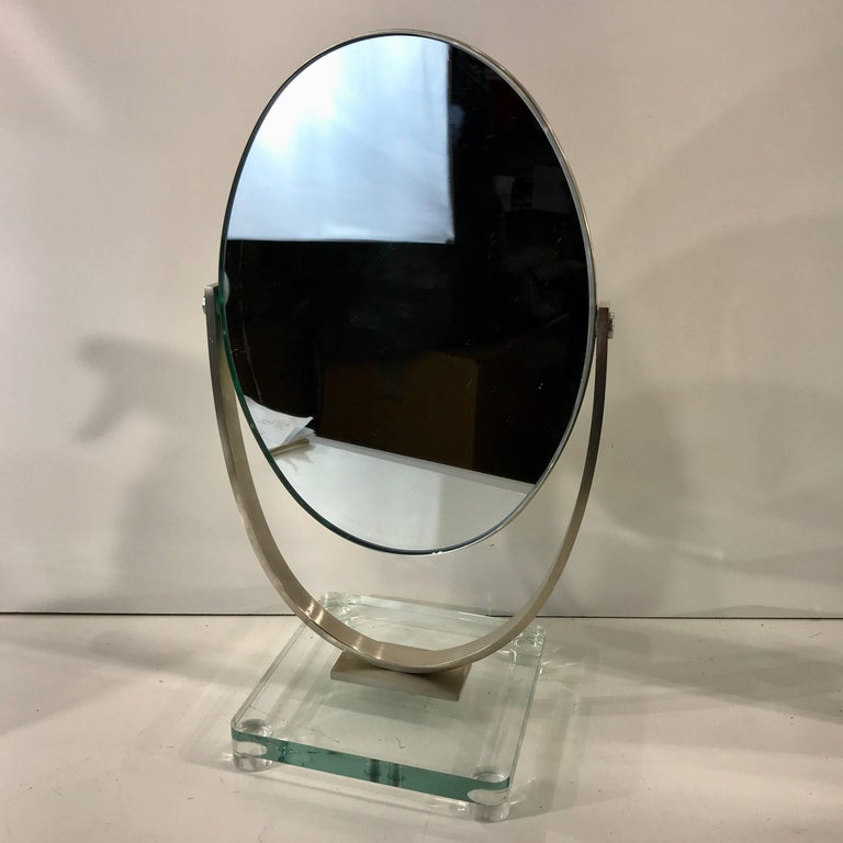 Two Charles Hollis Jones Vanity mirrors, each one double sided thick inset metal mounted oval mirrors, (measure: 9