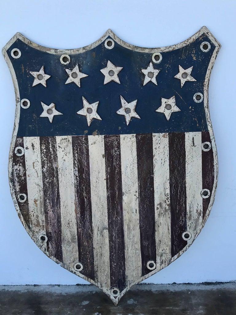 American Folk Art flag shield or sign with nine stars, a variation of the stars and bars flag (May 21, 1861-July 2, 1861) nine stars representing South Carolina, Mississippi, Florida, Alabama, Georgia, Louisiana, Texas, Virginia and Arkansas This