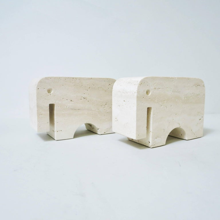 Pair of bookends elephant carved in a block of travertine from Rapolano designed and produced by Fratelli Mannelli in Signa, Italy, circa 1970. 