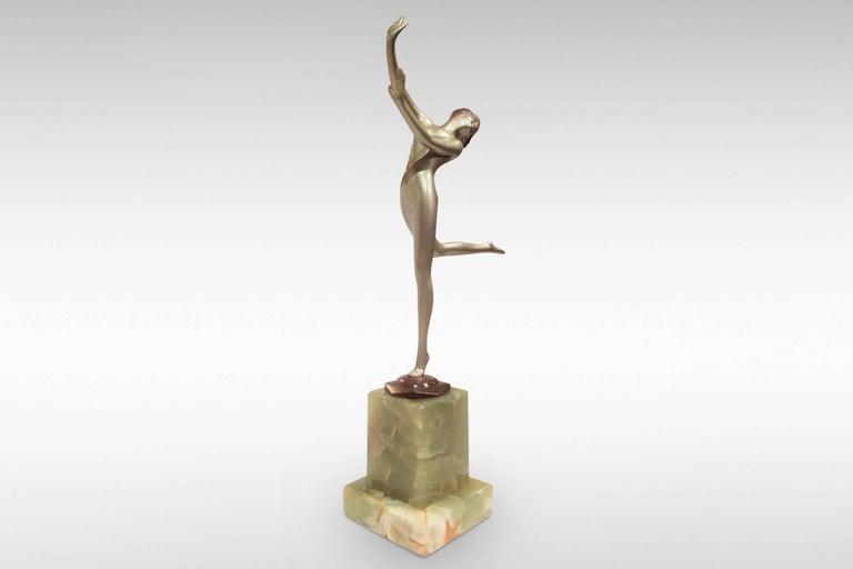 The glamorous 'Freedom', an Art Decosilvered bronze figurine by Josef Lorenzl, circa 1930.