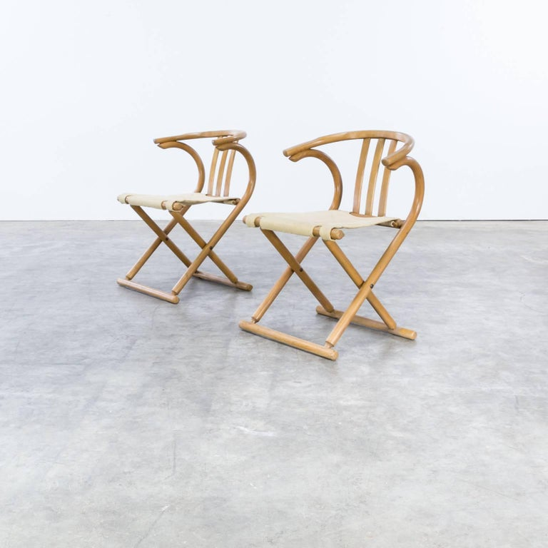 Thonet bentwood folding chair set of two. Good condition, wear consistent with age and use.