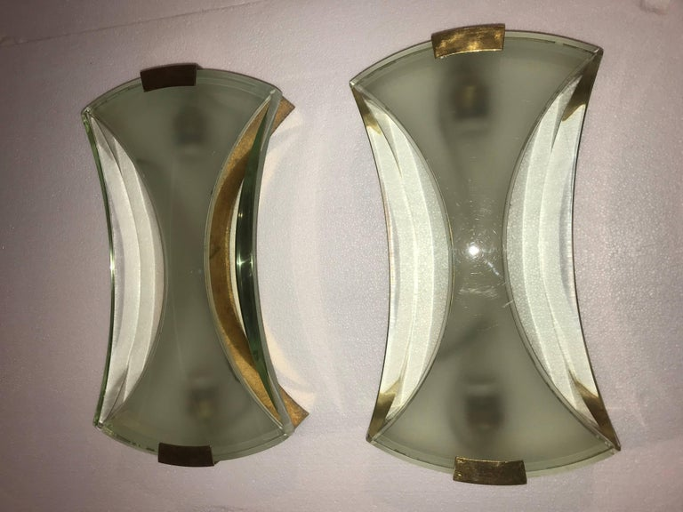 Mid-Century Modern sconces by Max Ingrand for Fontana Arte, in brass and cut  glass. There are 2 pairs available and both are in great original vintage condition.