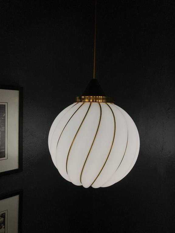 Beautiful pendant light by VeArt circa 1960, based on the design by Adolf Loos in opaline glass and brass.