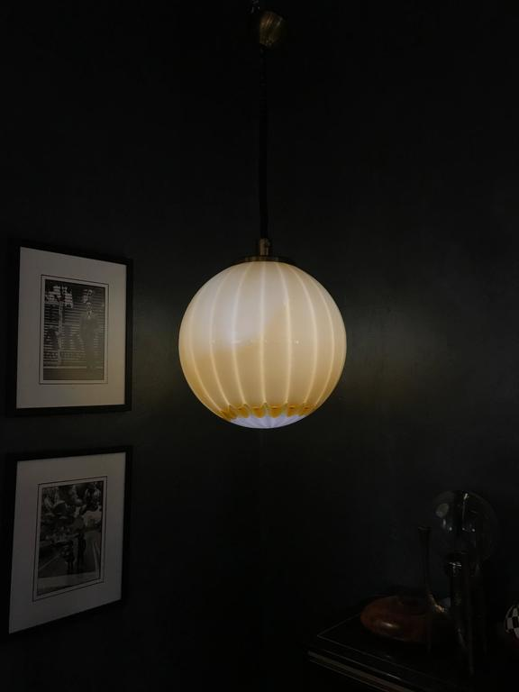A beautiful and large vintage pendant light in Murano glass of great quality and design.  Unsigned but the quality is equal to similar examples of Venini, Mazzega, Barbini or La Murrina,.