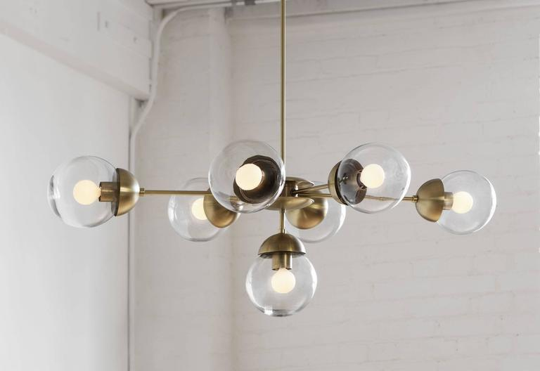 Mid-Century Modern Bounce-Oval Made to Order Brass Chandelier For Sale