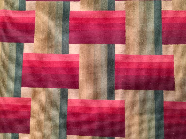 France Late 19th century, Napoléon III period Needlepoint  This needlepoint carpet is a unique piece with a very modern design. The alternation of vertical and horizontal red and green lines creates a movement that is very modernist and