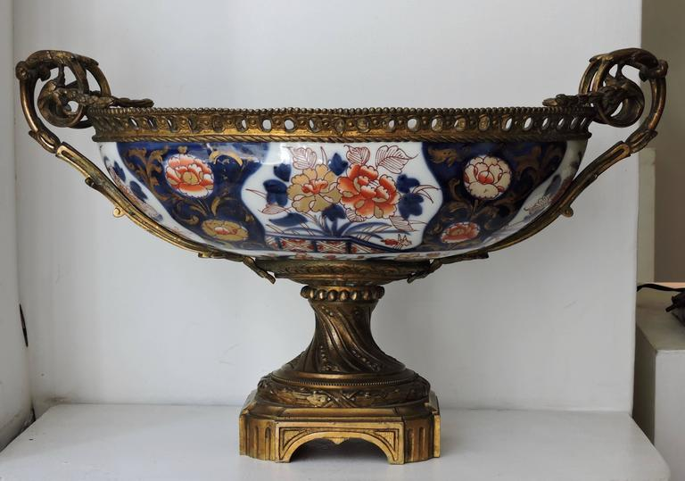 An oval shaped Bayeux porcelain in Imari style centrepiece Mounted in Louis XVI style gilt and chiseled bronze.