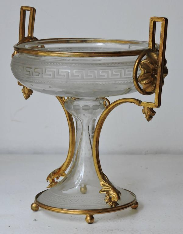 An very fine neoclassical engraved and ormolu-mounted crystal cup Designed with a Greek frieze circa 1870.